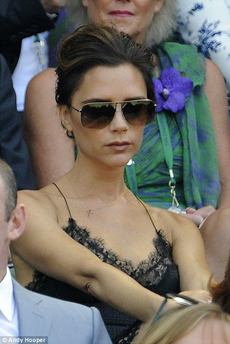 Spice Girl turned fashion mogul Victoria Beckham kept her cool in a skimpy dress on Centre Court