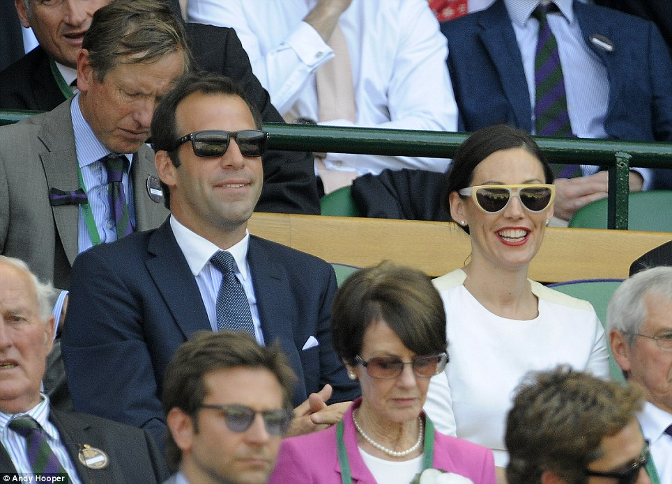 Former stars: Greg Rusedki, the former British number one, watched the Scotsman and the Serbian battle it out alongside his wife Lucy Connor in soaring temperatures on Centre Court