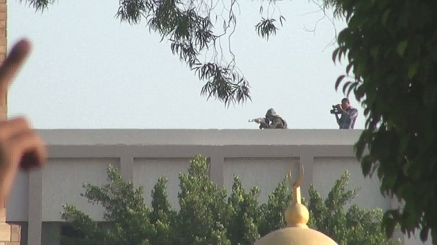 Army snipers were caught on camera shooting at a large crowd of Egyptian men this morning