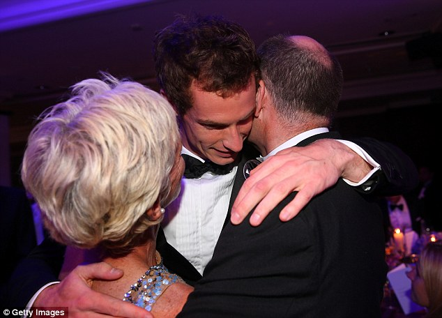 Family affair: Andy celebrates with his parents Judy and William