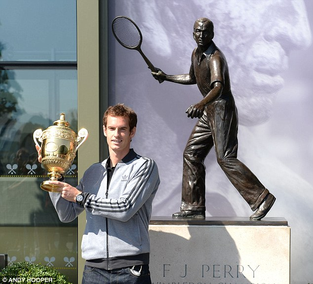 History man: Andy Murray parades the Wimbledon trophy in front of the statue of Fred Perry, the last British men's champion way back in 1936