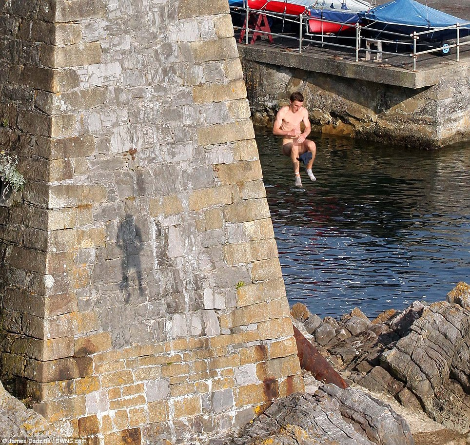 They have dubbed the new craze 'moonstoning' - a mix of both tombstoning and skinny dipping