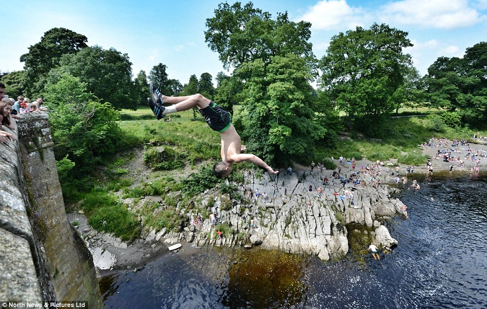 Despite many fatalities over the years, the latest last July, jumpers see the thrill as an exciting way to cool off during the hot summer weather, plunging 30ft from the historic bridge