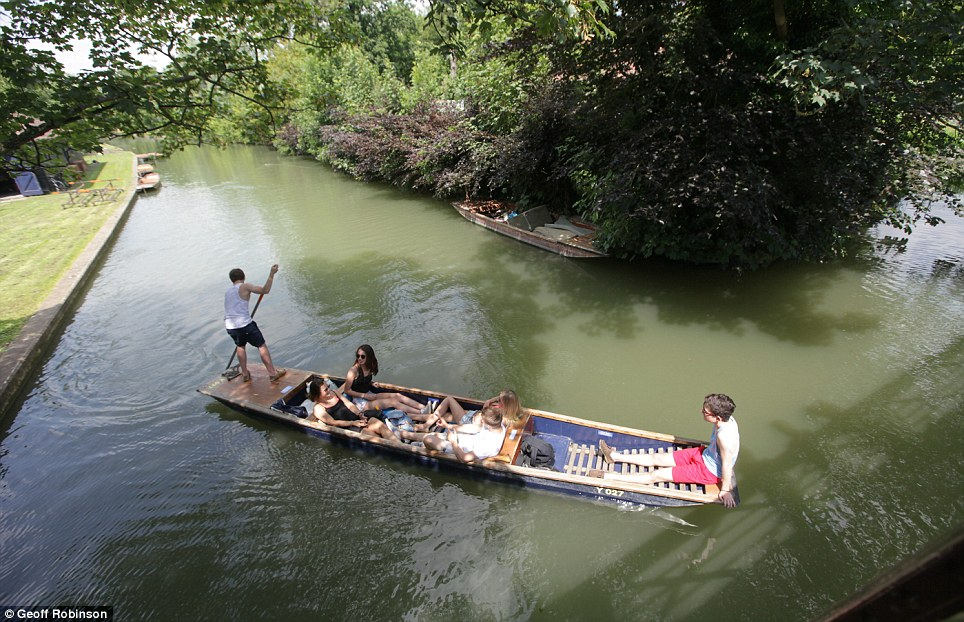 The river was packed with people punting, boating and picnicking as many made the most of the extremely warm weather
