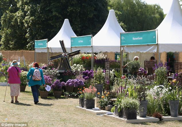 Exhibitors take in the view before the crowds arrive tomorrow