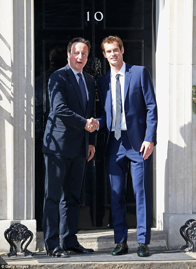 Cameron's photo opportunity: The Prime Minister shakes hands with Andy Murray outside Number 10 this afternoon as he congratulates him on winning Wimbledon