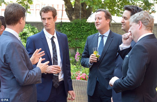 Greeting: Andy Murray drinks a glass of water as Liberal Democrat leader Nick Clegg speaks to him in the No 10 garden