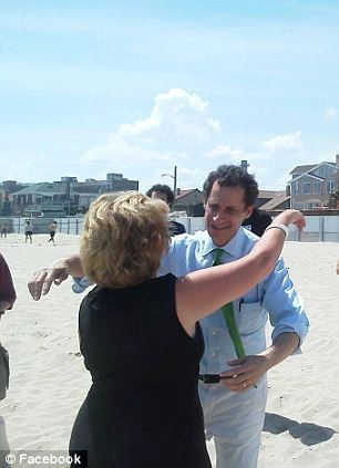 Back in the habit: Weiner has been out campaigning as part of his race to become the next mayor of New York City, seen at left on Monday with a bike store owner and at right on the beach in Rockaway over the weekend