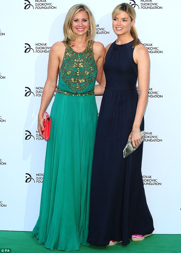 Effortlessly chic: Isabella looked elegant in a midnight blue silk gown as she posed for a photograph with sister-in-law Holly