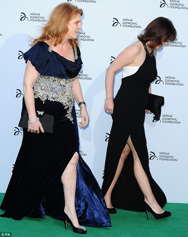 The thigh's the limit: The pair both opted for floor-length gowns with daring thigh-high splits