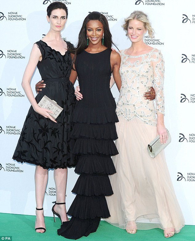 Model behaviour: Naomi posed alongside fellow mentors  Erin O'Connor and Caroline Winberg,from the UK version of The Face on the green carpet