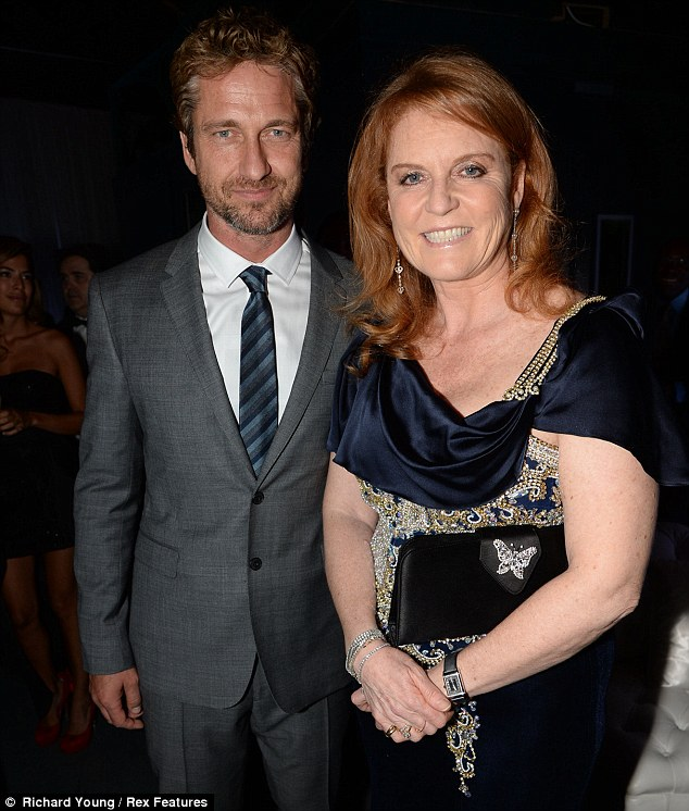 New pals: Fergie seemed to have found a new friend in the form of actor Gerard Butler, with the pair seeming to be getting along famously as they chatted inside the venue