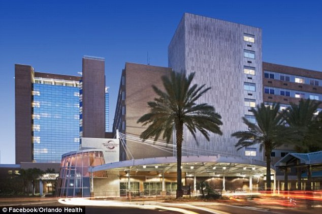Victim: The allegedly cheating father is at Orlando Regional Medical Center, pictured, where he is being treated in the neurological intensive car unit