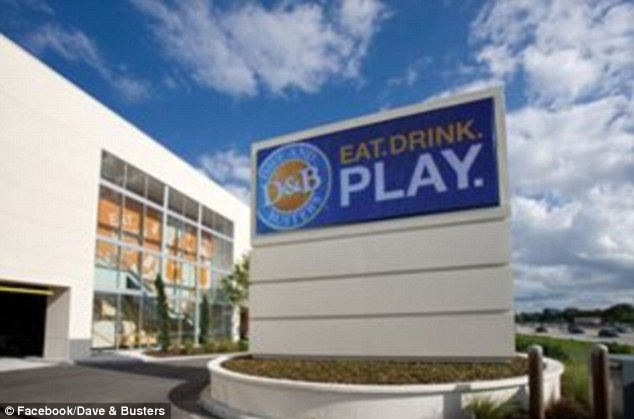Family dinner: Harris, 21, noticed his dad was receiving text messages from his lover while the family was eating at Dave and Buster's restaurant, pictured, in Orlando, Florida