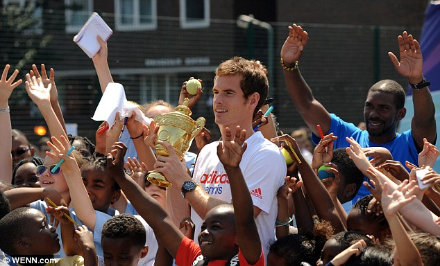 Down to earth: Less that 24 hours after becoming the first British man since 1936 to win the Wimbledon singles, Murray was wowing kids in south London