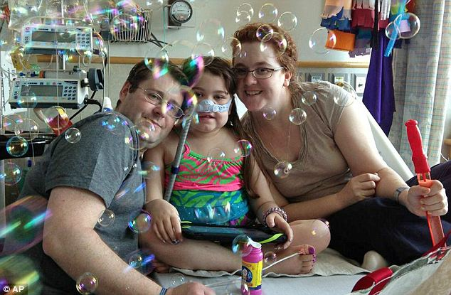 Brave: Sarah celebrated the 100th day of her stay in Children's Hospital of Philadelphia on May 30 with bubbles. Her mother Janet (right) and father Fran (left) sued to change national rules on lung transplants