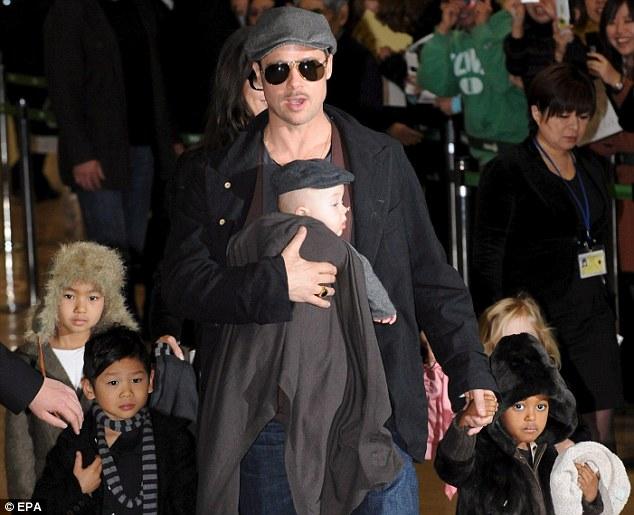 Hollywood royalty: Brad Pitt with five of his six children, from left, Maddox, Pax, Knox, Zahara and, behind Zahara, Shiloh