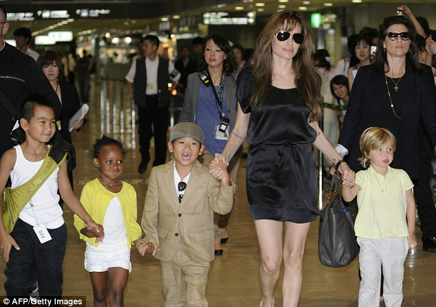 The royal cousins: Angelina Jolie's six children - four of them, from left to right, are Maddox, Zahara, Pax and Shiloh - will be 27th cousins with the Royal baby