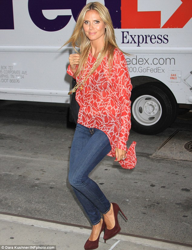 She's a peach: Heidi Klum looked in fine shape as she went walkabout in New York on Monday