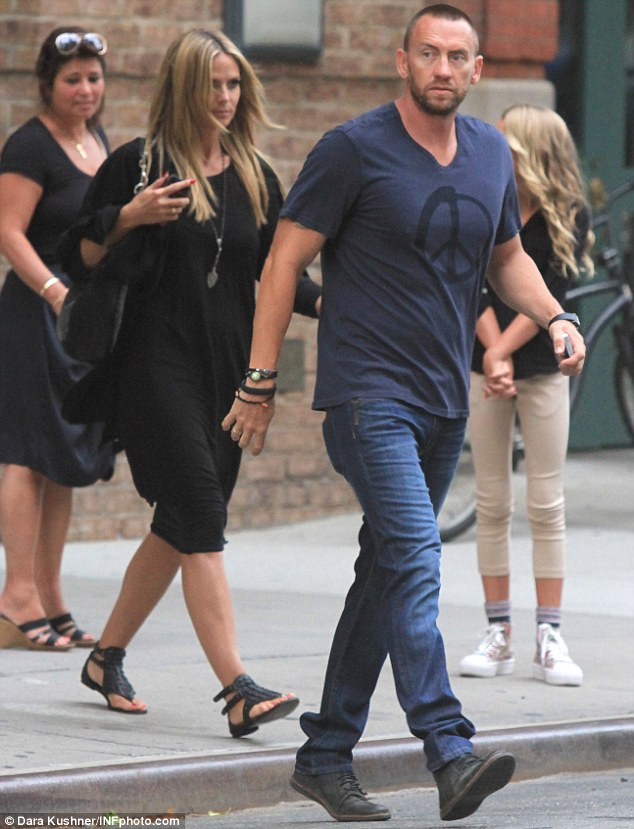 Peace of meat: Hedi's bodyguard turned boyfriend wore an uplifting T-shirt when they went walkabout