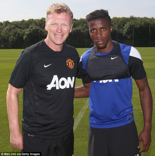 Welcome aboard: Manager Moyes greets new signing Wilfried Zaha