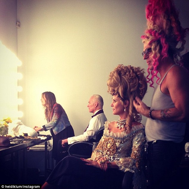 Elaborate costumes: Heidi captioned this picture 'getting me ready for me closeup' as Tim Gunn was prepped beside her