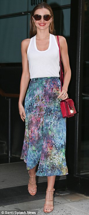 Day to night: Miranda easily carried the look into the evening by simply letting her brunette locks loose