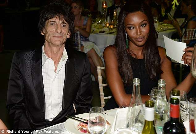 Plenty to catch up: Ronnie Wood looked pleased to be seated alongside Naomi Campbell