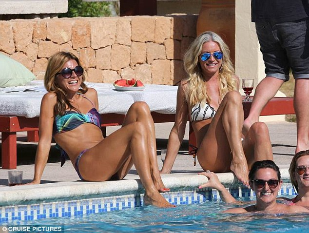 Kicking back: The presenter pals seemed completely relaxed as they reclined by the side of the pool