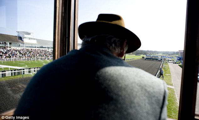 Trouble: The file photo shows a steward watching on at Lingfield racecourse in England