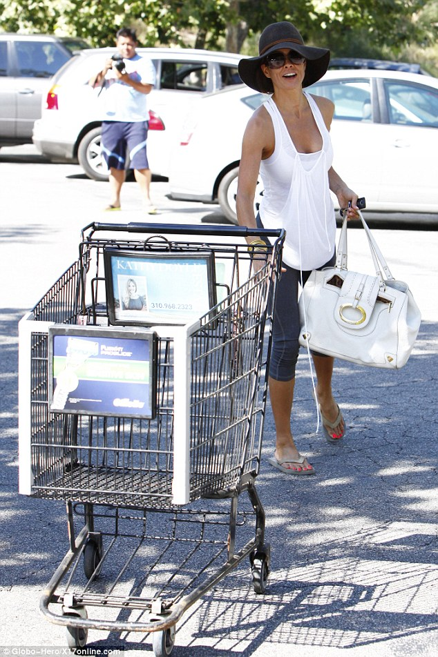 Cart return: Brooke pushes the empty trolley back into its bay