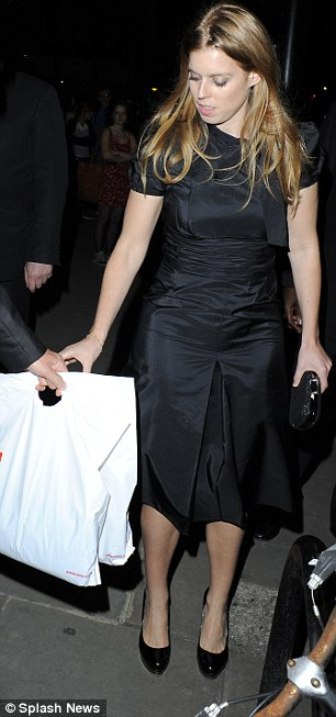 Hands full: Fergie was seen with a blonde friend who clutched a goody bag as the pair left, while Beatrice also toted a gift bag