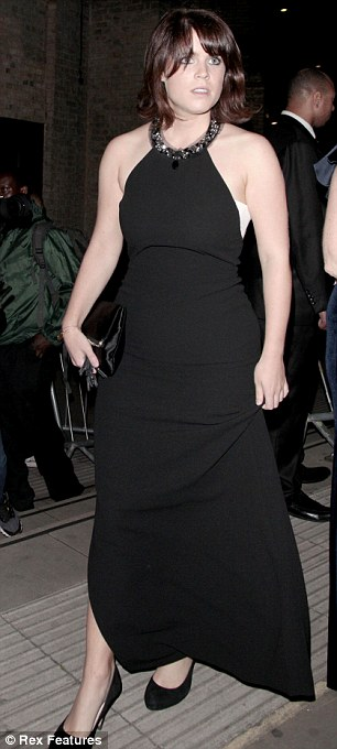 Leggy: Eugenie's monochromatic dress featured a thigh-high split