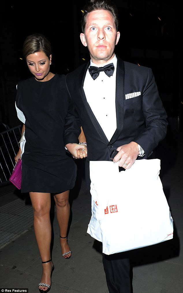Leading the way: Nick Candy kept a tight hold of wife Holly as the pair left the gala evening