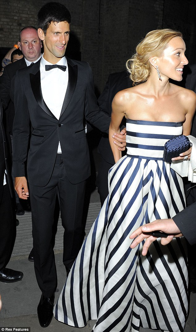 The white stripes: Novak Djokovic's partner Jelena Ristic looked stunning in her evening gown as the pair left the fundraiser