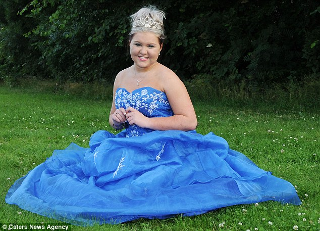 Celebration: Paige wore a custom-made royal blue gown to her prom, which her mother said marked the end of 'five years of hell' for her daughter