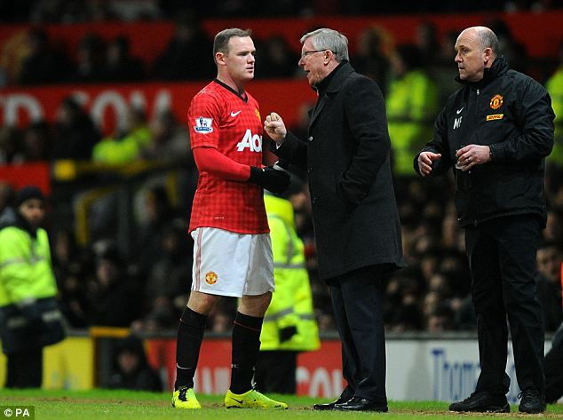 Strained: Manchester United manager Sir Alex Ferguson speaks with Rooney on the touchline