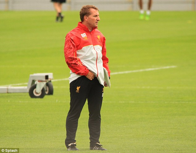 Back to work: Brendan Rodgers and Liverpool are back in pre-season training