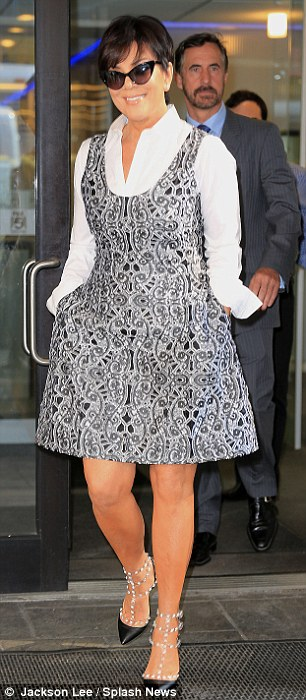 Tiny arms! The 57-year-old momager also wore a white blouse, Valentino studded stilettos, and black cat-eye sunglasses as she emerged from FoxNY studios