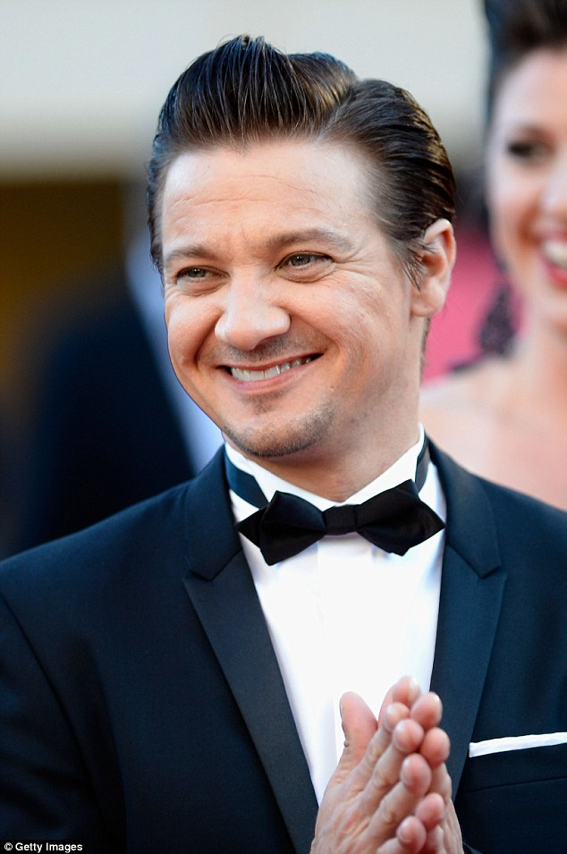 Happy guy: Jeremy Renner could net a health profit on his stunning Beverly Hills mansion laughs during Cannes Film Festival in May