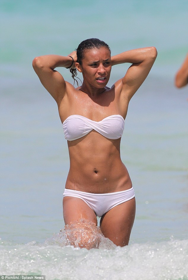 Beach babe: Melody Thornton showed off her toned figure in a skimpy two-piece as she frolicked in the ocean in Miami Beach, Florida on Wednesday