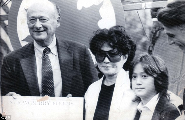 New York Mayor Ed Koch, left, poses with Yoko Ono, widow of slain musician John Lennon, and her son Sean Lennon, 10, during a dedication ceremony in 1985 for Strawberry Fields, a memorial to Lennon, in Central Park
