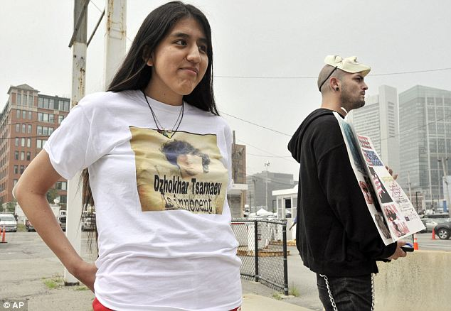 Supporters: Jennifer Michio, left, and Duke La Touf, right, stand in support of  Tsarnaev outside the federal courthouse prior to his arraignment Wednesday in Boston