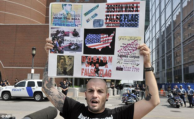 Wake up: Duke La Touf holds a sign in support of Tsarnaev outside the same Boston courthouse where the Whitey Bulger trial is in its fifth week