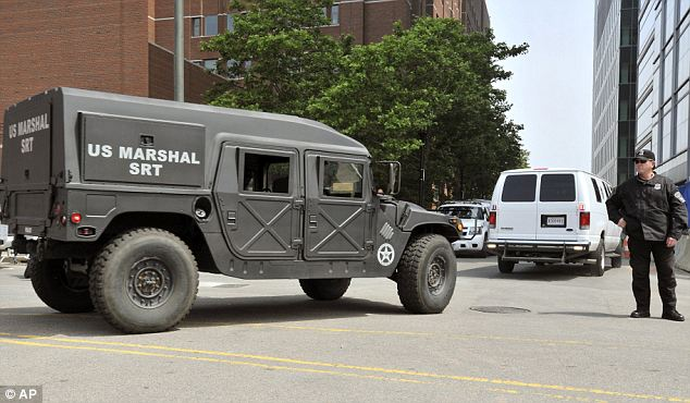 Heavy security: The U.S. Marshal's van believed to be carrying Tsarnaev is followed by a humvee as part of a motorcade that ushered him to his first public appearance since the April 15 bombings