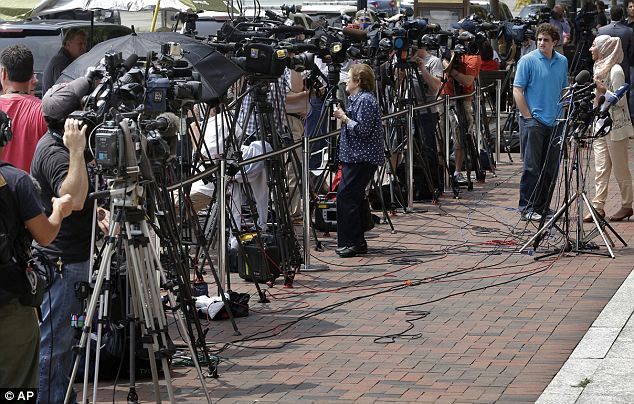 Worldwide interest: Intense media interest had reporters swarming the courthouse Wednesday, representing countries all over the world as Tsarnaev made his brief and disheveled court appearance