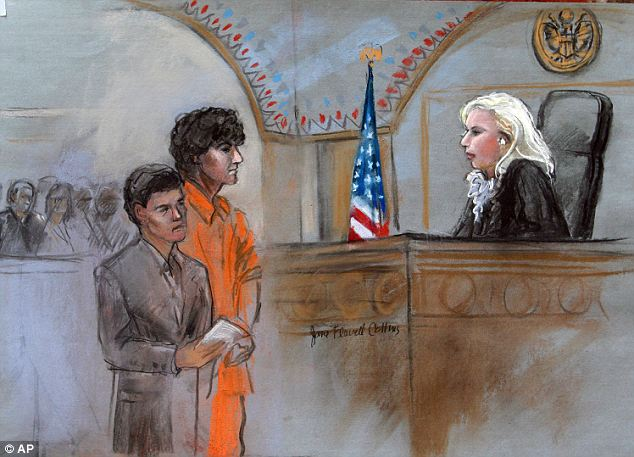 'Twitchy': Tsarnaev stands with attorney Judy Clarke, left, before Judge Marianne Bowler, during the arraignment. Witnesses said Tsarnaev appeared to twitch slightly throughout the proceedings