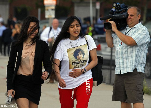 Fans? Michio and a companion leave following Wednesday's arraignment