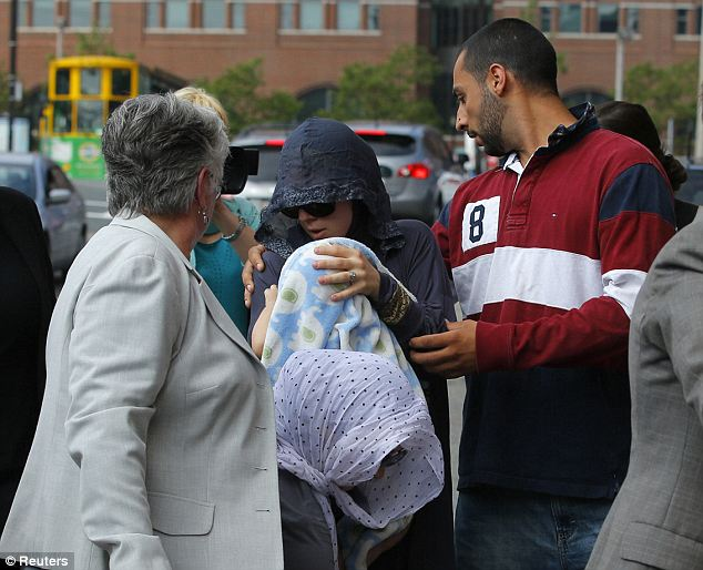 Family members of Dzhokhar Tsarnaev leave the federal courthouse following the arraignment Wednesday. Tsarnaev blew his sobbing sisters a kiss as ke left in shackles