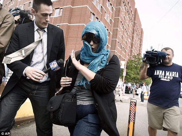 A supporter of Boston Marathon bombing suspect Dzhokhar Tsarnaev leaves federal court after his arraignment Wednesday in which victims and their families sat alongside a dozen Tsarnaev supporters